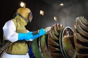 A worker working in a sandblast workshop
