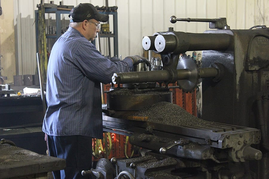 A fabricator at Swanton Welding demonstrating CNC Machining