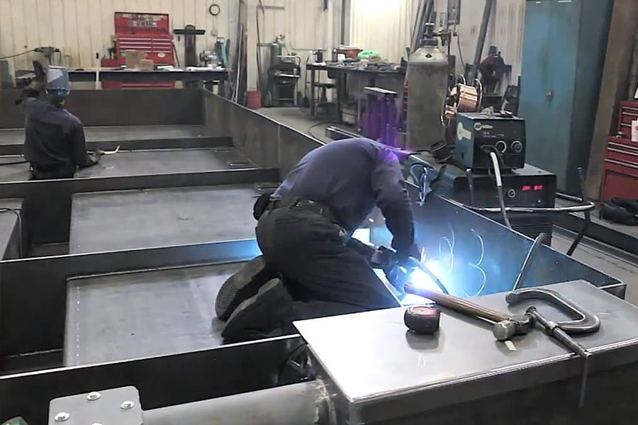 Welder-fabricating and welding on a piece of structural steel
