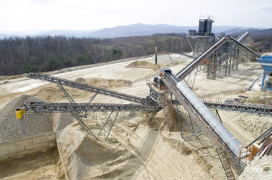 Two belt conveyors in Gravel Quarry in cloudy day
